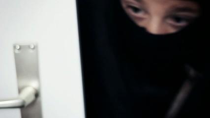 masked burglar open the door