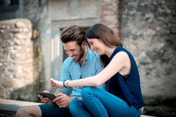 young beautiful couple lovers using tablet