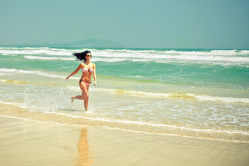 Girl running along the beach