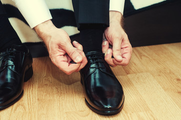 Business man dressing up with classic, elegant shoes