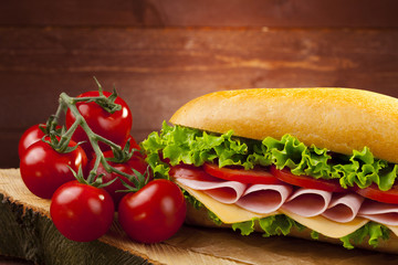 big sandwich with ham, cheese and vegetables