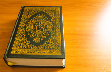 quran on the wooden table