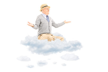 Senior man gesturing with hands seated on a cloud