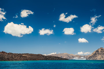 Beautiful sky clouds and cruise ship near the Greek Islands