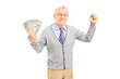 Senior holding cash and gesturing happiness