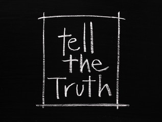 Tell the Truth written in white chalk on a blackboard
