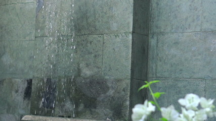 Water falling from outdoor shower, super slow motion
