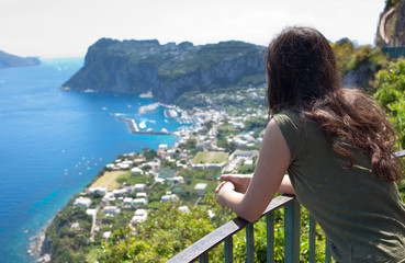 Girl from behind watching the view of Marina Grande in Capri