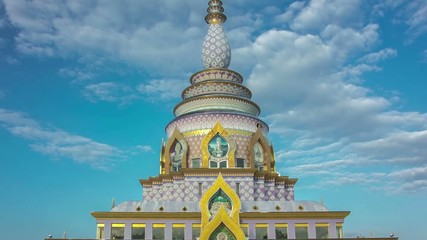 Time lapse colorful pagoda day to night zoom out