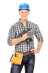 Male carpenter holding an electric drill