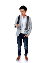 Asian man trying to choose a tie over white background