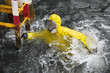 worker in  protective suit in sea  reaching ladder