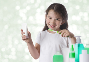 School girl brushing teeth on blurred background