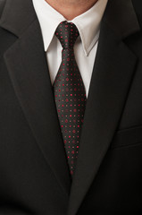 Black suit and tie.