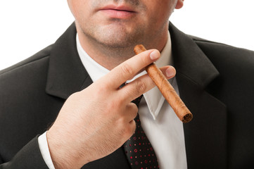 Confident business man holding a cuban cigar.