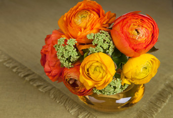 Bouquet of ranunculus flower in an yellow vase