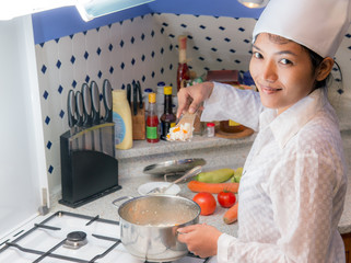Asian woman to cook in the kitchen