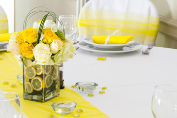 yellow and white wedding table decoration