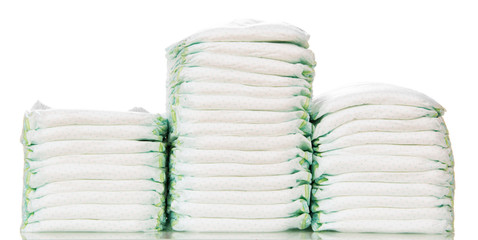 Three stacks of diapers