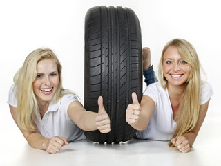Girls show thumbs up for tire changing