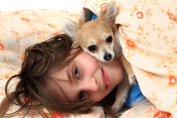 girl and chihuahua in the bed