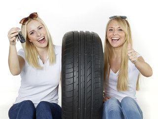 Two girls with tire and carkey