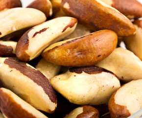 A close-up of Brazil nuts on a white background