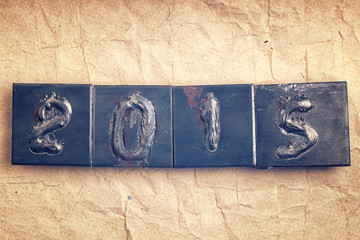 Concept of New Year 2015 made from metal numbers on old vintage