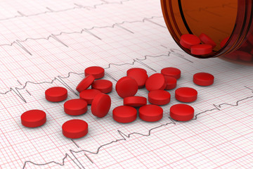 3D model of red pills spilled on electrocardiogram (ECG) report