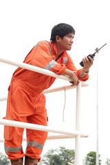 communicating on walkie-talkie at site
