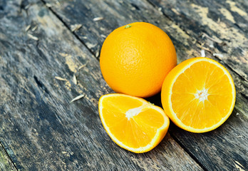tangerines  on wooden table on grey background