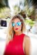 Blond woman with sunglasses in the city