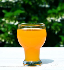 orange juice in a glass natural background