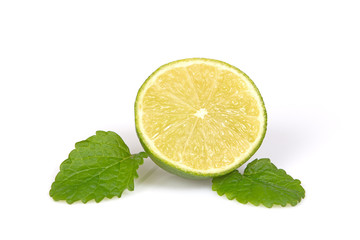 Fresh half of citrus lime with mint leaves.