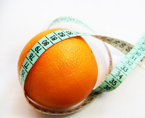 Fruits and measurement tape on the white background