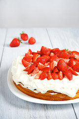 Strawberry cake with whipped cream