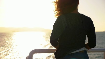 Casual Style Girl Admiring Beautiful Seascape during Sunrise