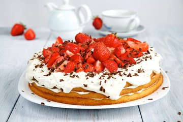 Strawberry cake with whipped cream with chocolate