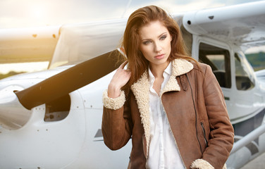 Portrait of beautiful woman aviator in airport