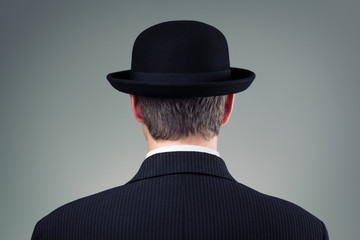 Businessman in bowler hat