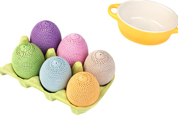 Colorful crocheted eggs in a box