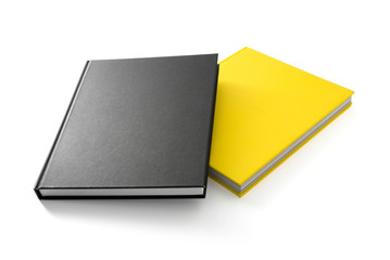 Two books (yellow and black) with blank covers isolated on white