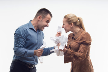 Colleagues fighting each other with paper in fists