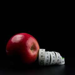 Apples with meter on dark background