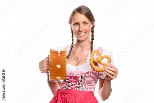 canvas print picture Lächelnde Frau im Dirndl mit einem Bier und Brezel