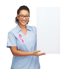 female doctor or nurse with white blank board