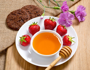 Strawberries, honey, cookies and cloves