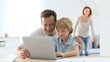 Parents with children using laptop computer at home
