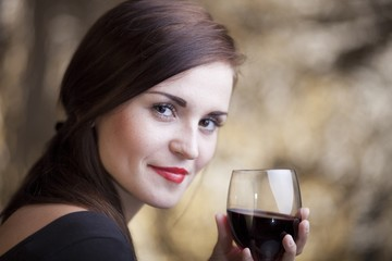 Elegant glamour woman with glass of red wine