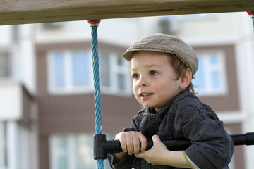 Boy climbing a rope ladder